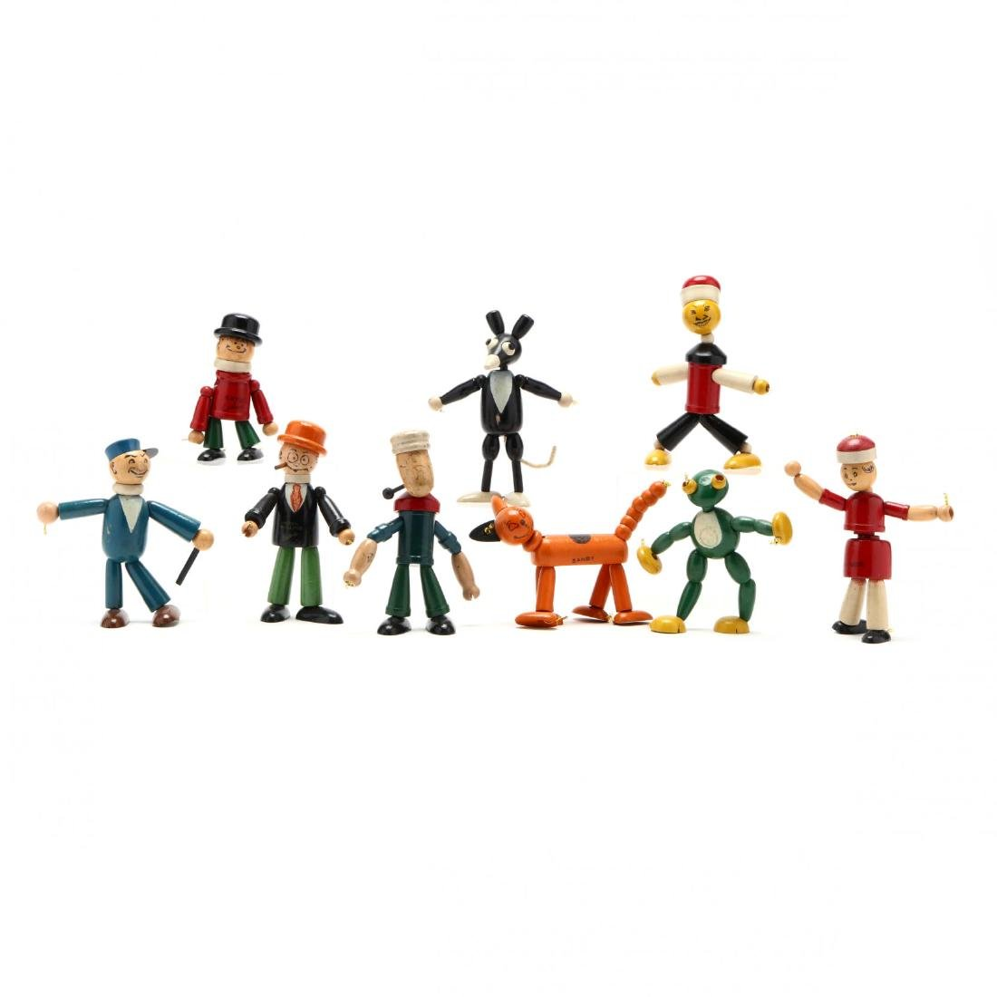 A Group of Articulated Wooden Toys