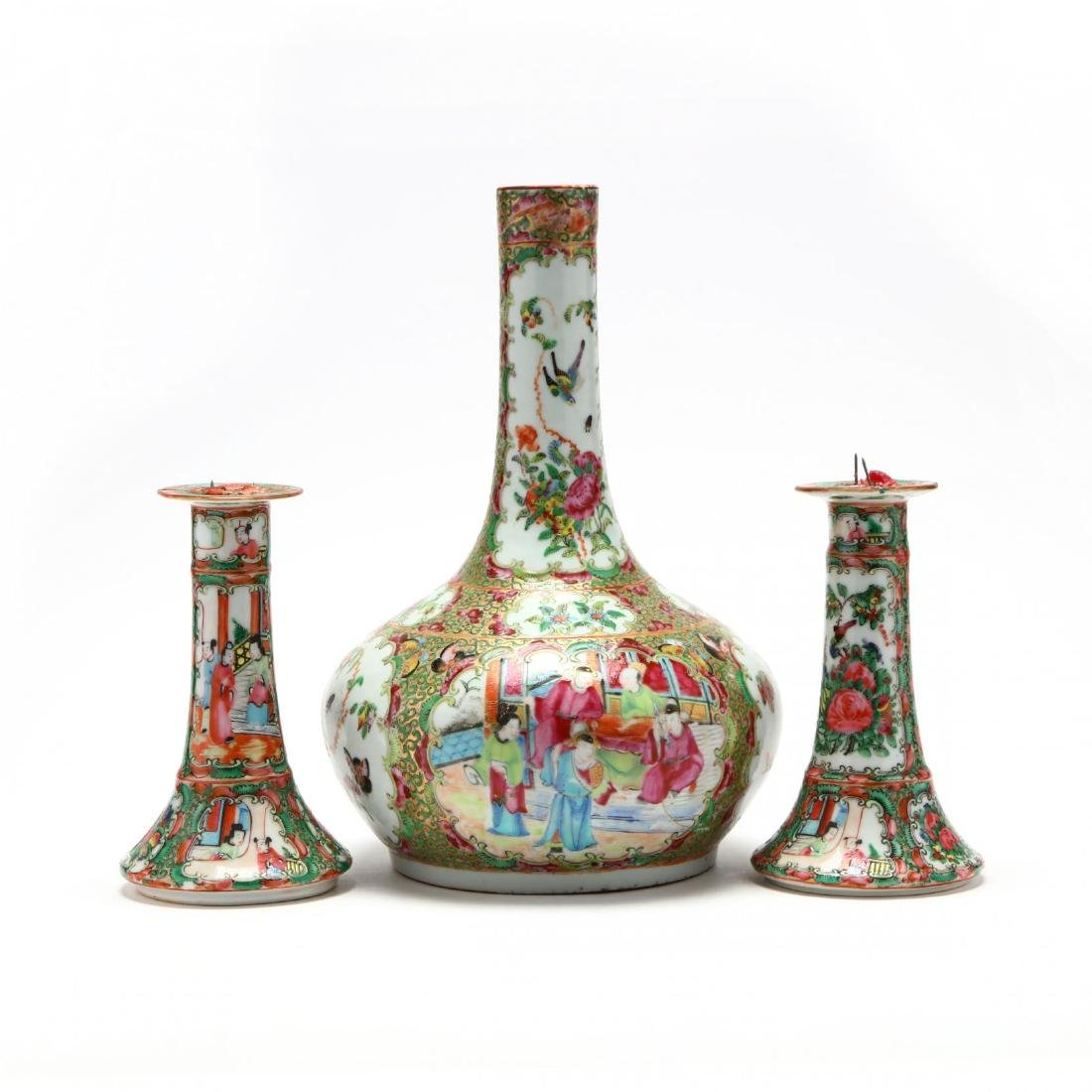 A Chinese Famille Rose Pair of Candle Sticks and Bottle