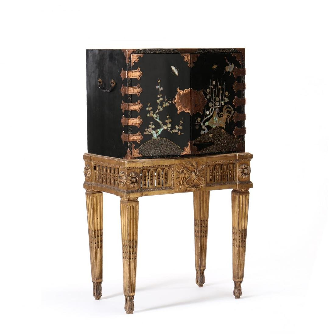 A Japanese Lacquered Cabinet on a Carved Giltwood Stand