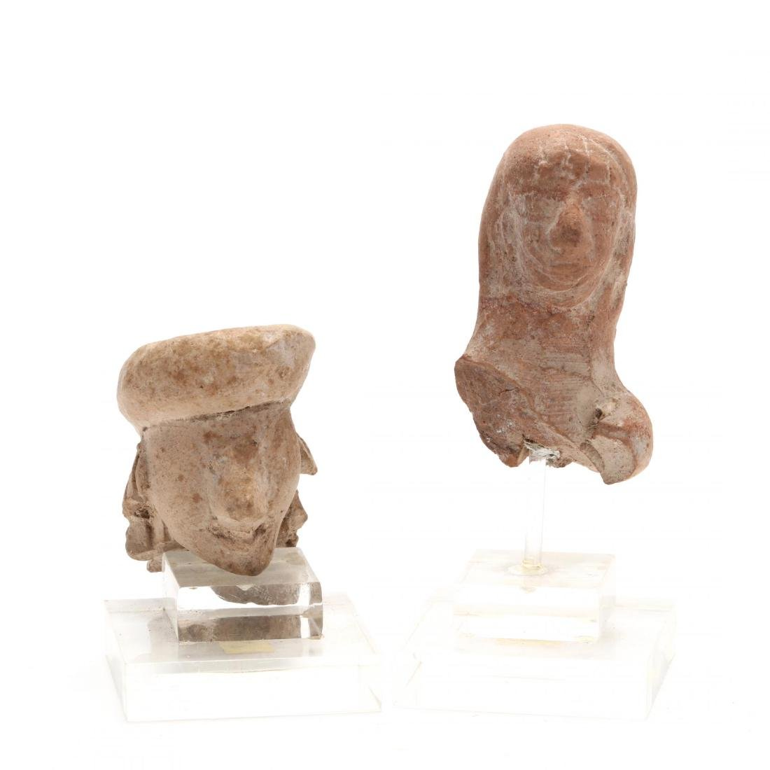 Two Cypro-Archaic Terracotta Heads