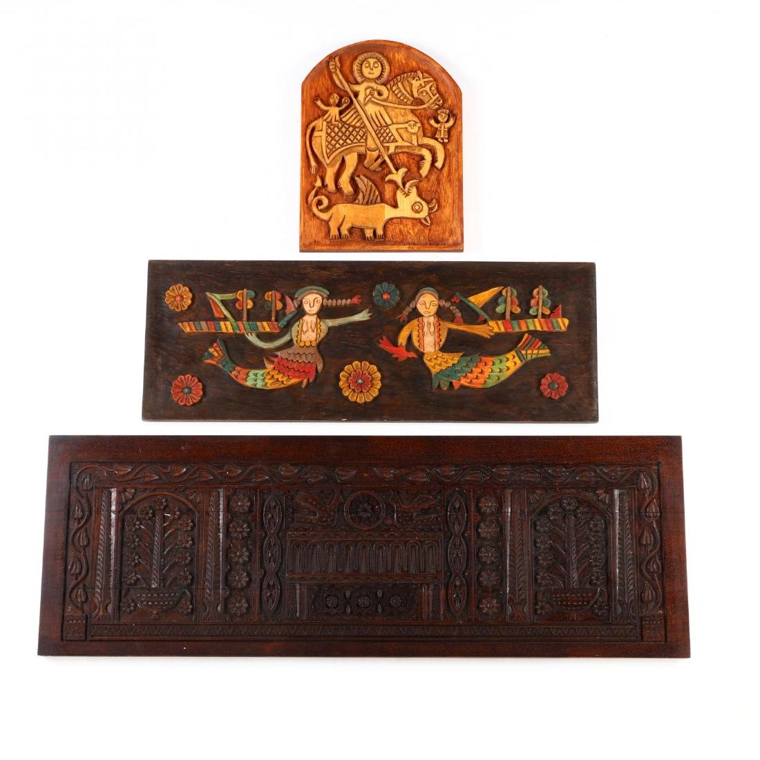 Three Carved Wooden Panels