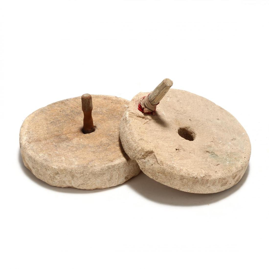 Two Antique Mill Stones