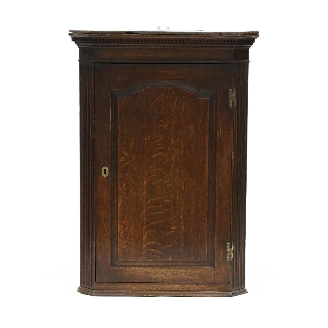 George III Carved Oak Hanging Corner Cupboard