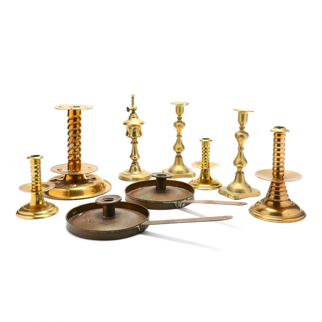 Nine Brass Candlesticks