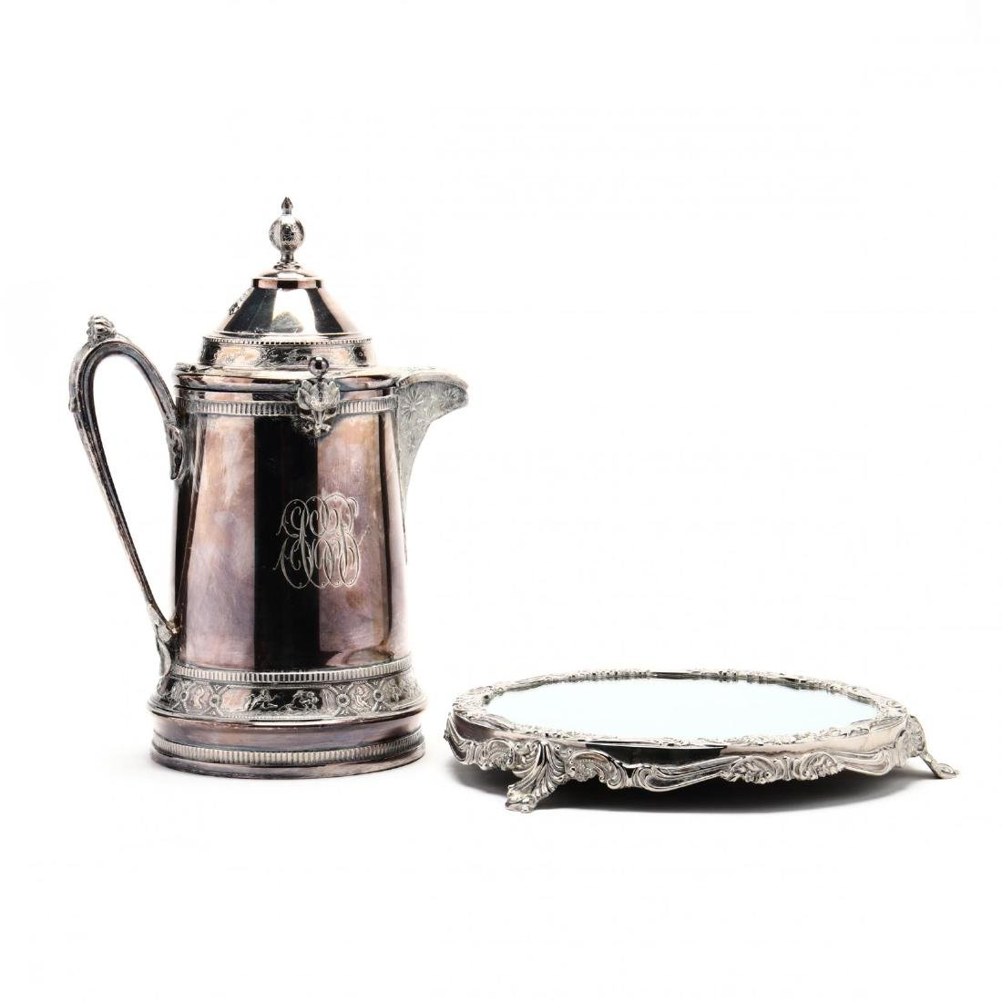 A Silverplate Ice Water Pitcher and Mirrored Plateau