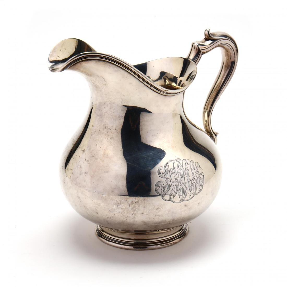 An Antique Sterling Silver Water Pitcher