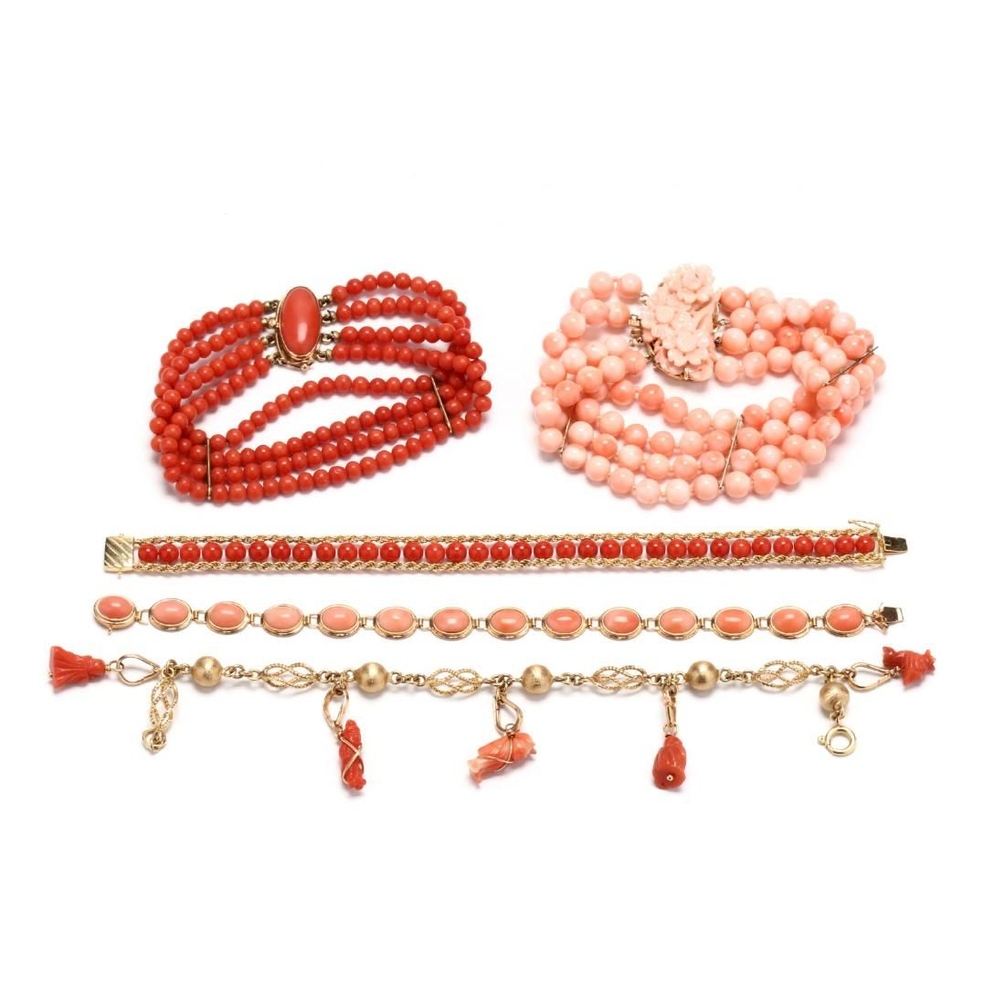 Group of Gold and Coral Bracelets
