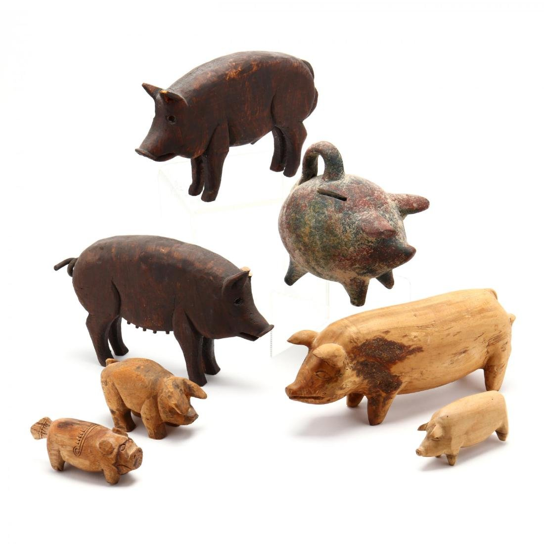 A Collection of Seven Pig Sculptures