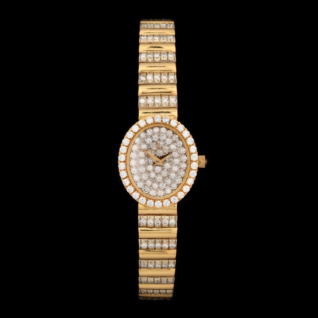 Lady's 18KT Gold and Diamond Watch, Baume & Mercier
