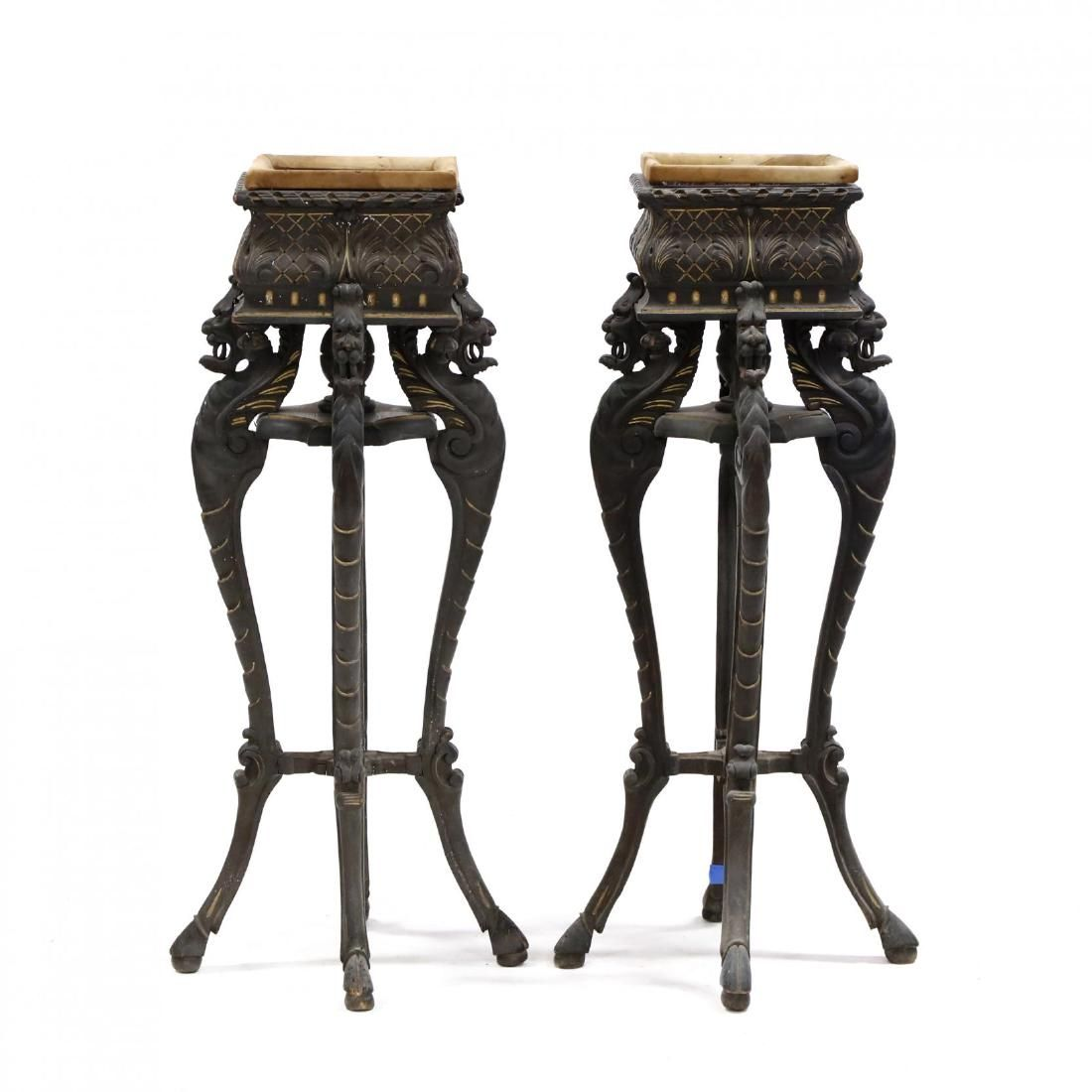 Pair of Continental Carved Ebonized and Gilded