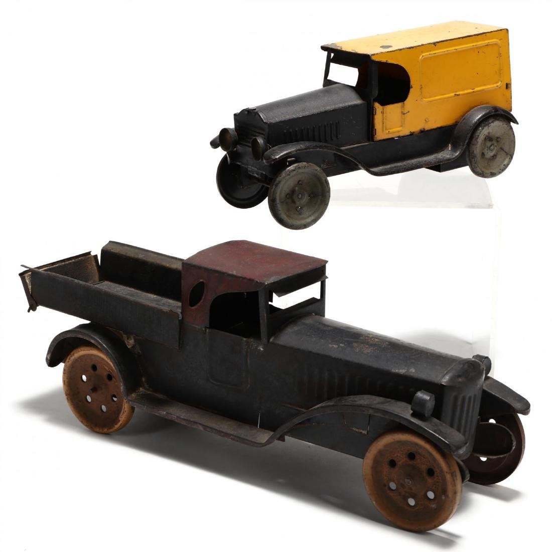 Two Antique Pressed Tin Toy Trucks