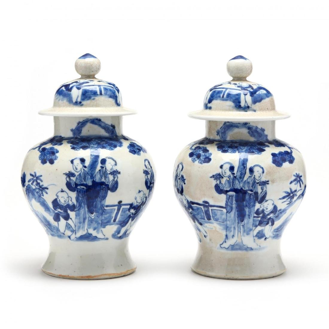 A Pair of Chinese Figural Ginger Jars