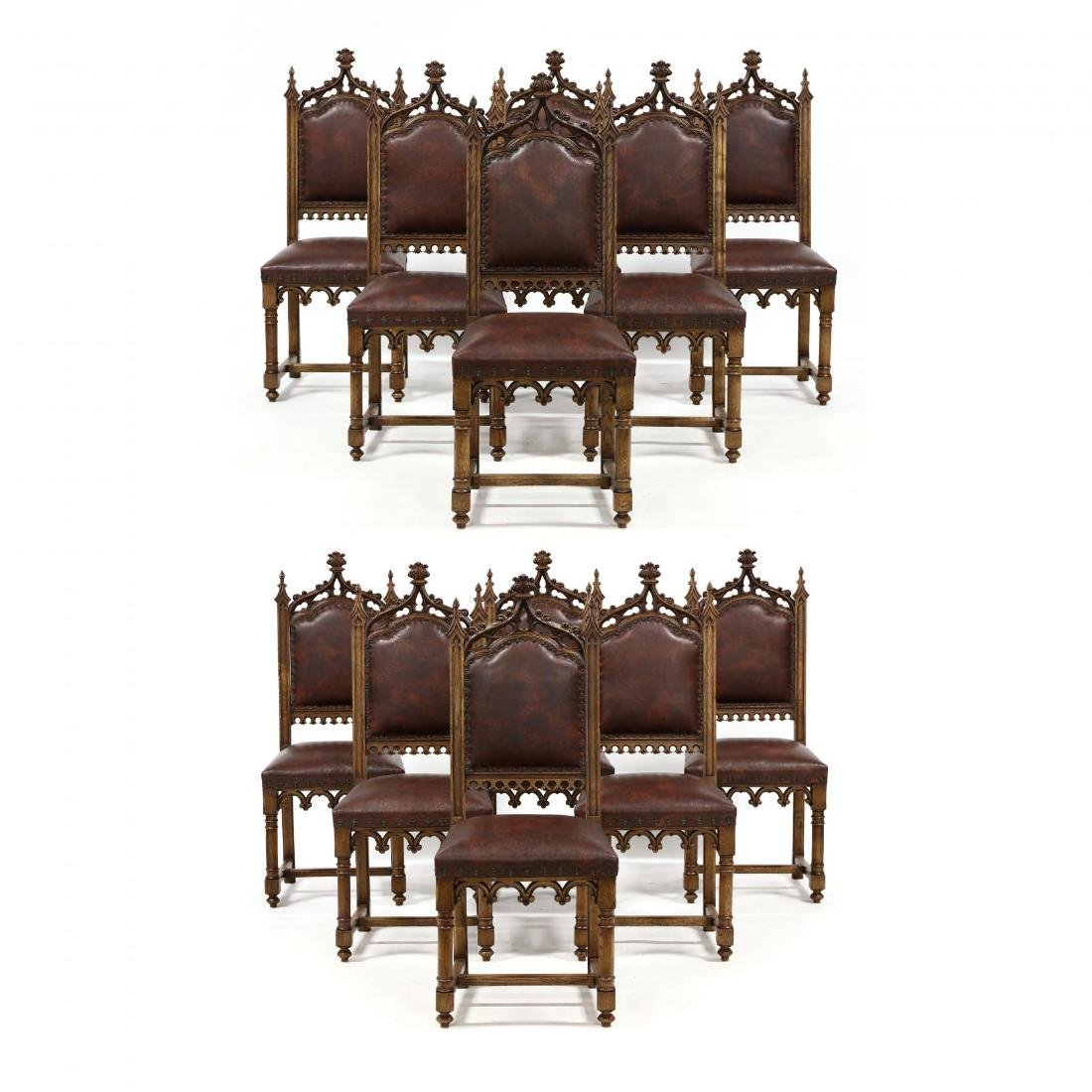 Set of Twelve Gothic Style Carved Oak Dining Chairs