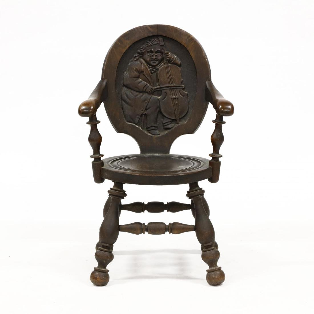 Continental Relief Carved Oak Armchair
