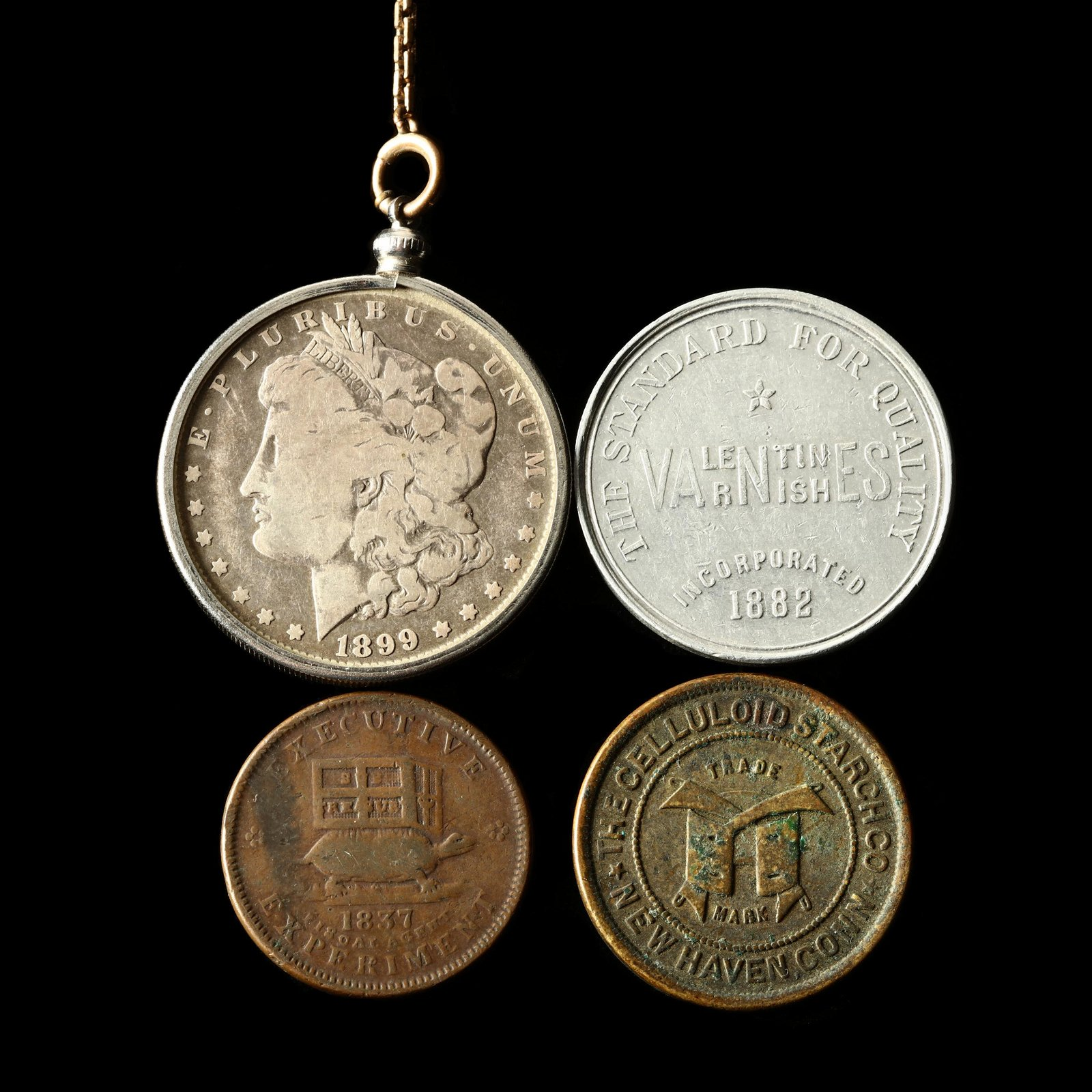 Mounted Silver Dollar and Three Tokens