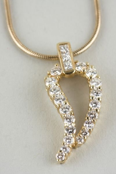 24: 14KT Yellow Gold and Diamond Leaf Motif Pendant,