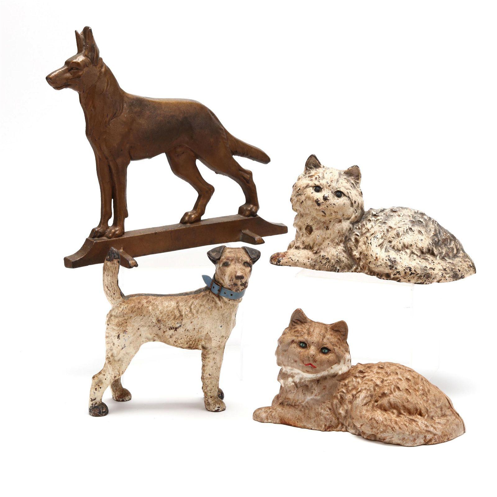 Four Antique Cast Iron Animal Doorstops, including