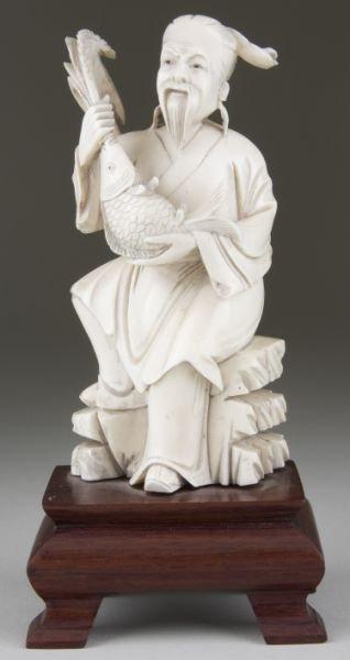 21: Japanese Carved Okimono of Seated Man With Koi