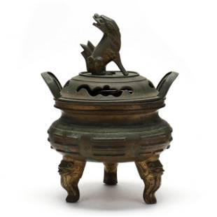 A Chinese Bronze Covered Censer