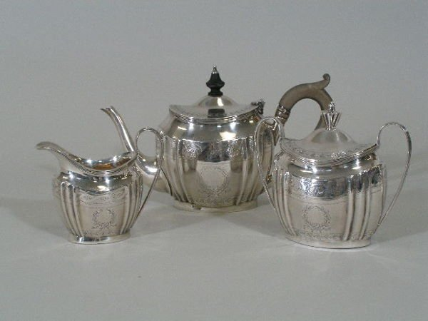 1023: Three Piece Sterling Silver Tea Set,