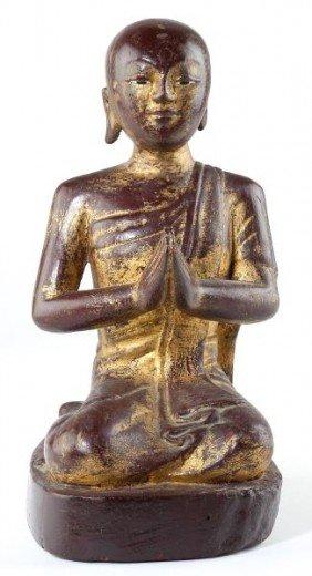Southeast Asian Monk In Attitude Of Prayer