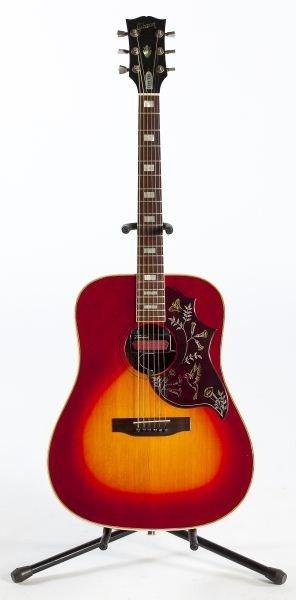 696: 1974 Gibson Hummingbird Flat Top Guitar