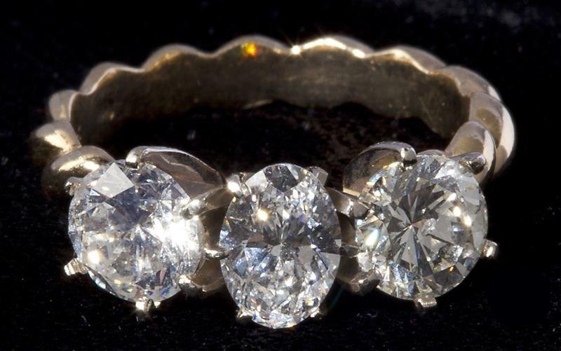 106: Three Stone Diamond Ring