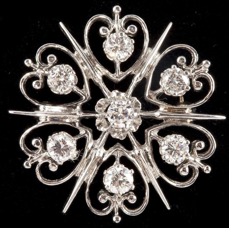 113: Platinum and Diamond Flower Brooch, Merrin