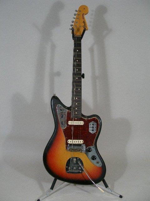 1003: Vintage Fender Jaguar Solid Body Electric Guitar,