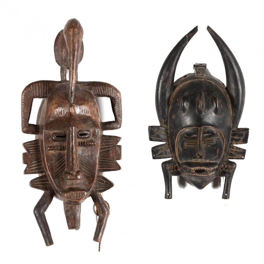 Ivory Coast, Two Senufo Kpelie Masks