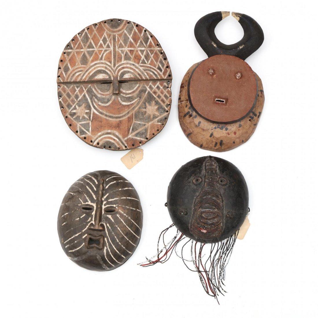 Four Circular Form West African Masks