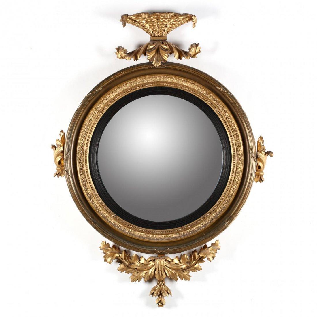 A Regency Carved and Gilded Bullseye Mirror