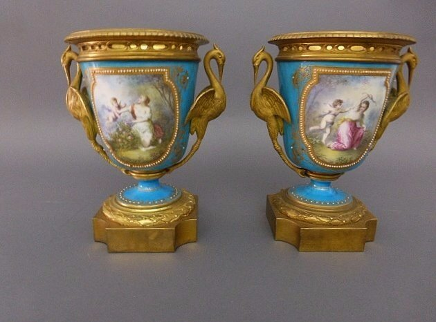 A PAIR OF 19TH CENTURY JEWELED SEVRES STYLE VASES