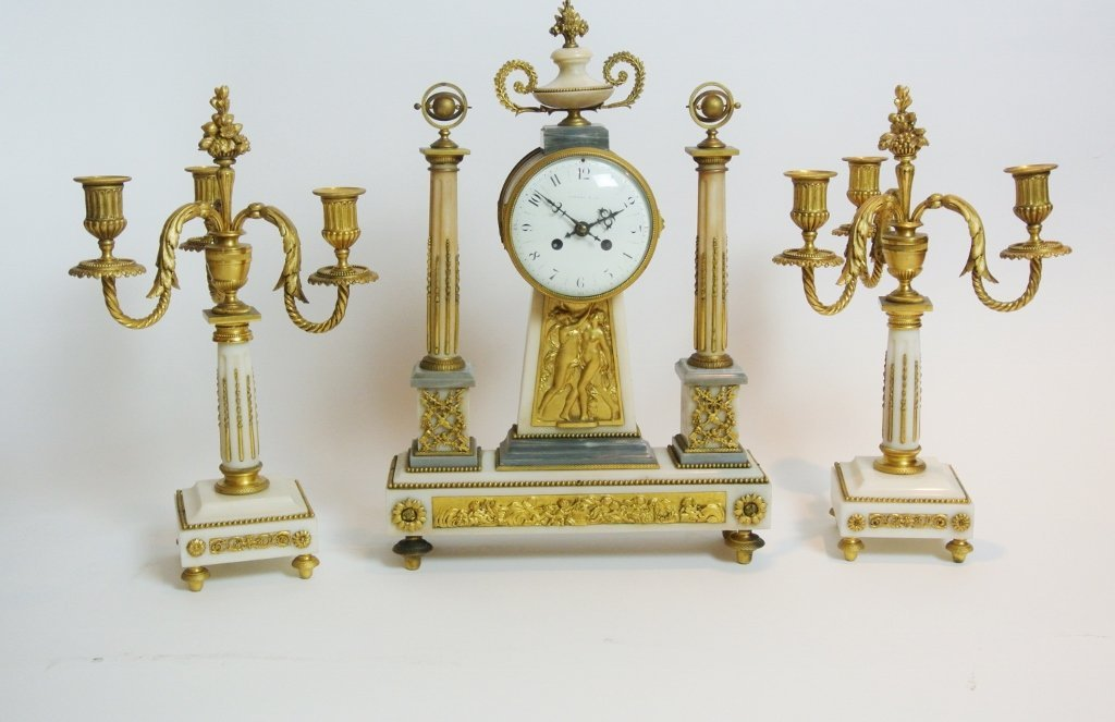 A TIFFANY ORMOLU AND MARBLE CLOCK GARNITURE