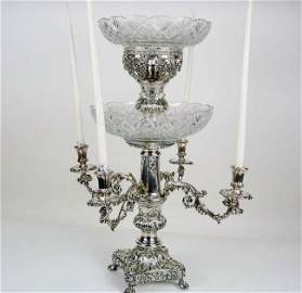 A MONUMENTAL SILVER PLATED CENTERPIECE WITH CRYSTAL
