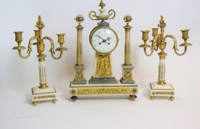 A TIFFANY ORMOLU AND MARBLE CLOCK GARNITURE