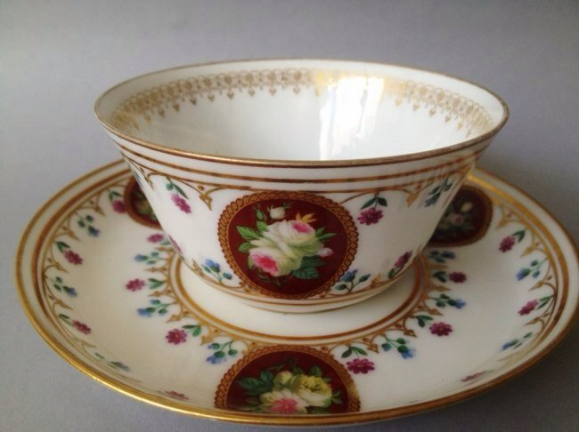 A SEVRES CUP AND SAUCER