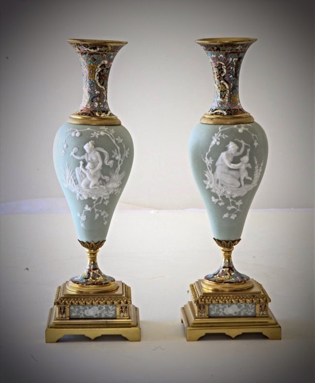 A PAIR OF 19TH CENTURY CHAMPLEVE ENAMEL & PORCEALIN