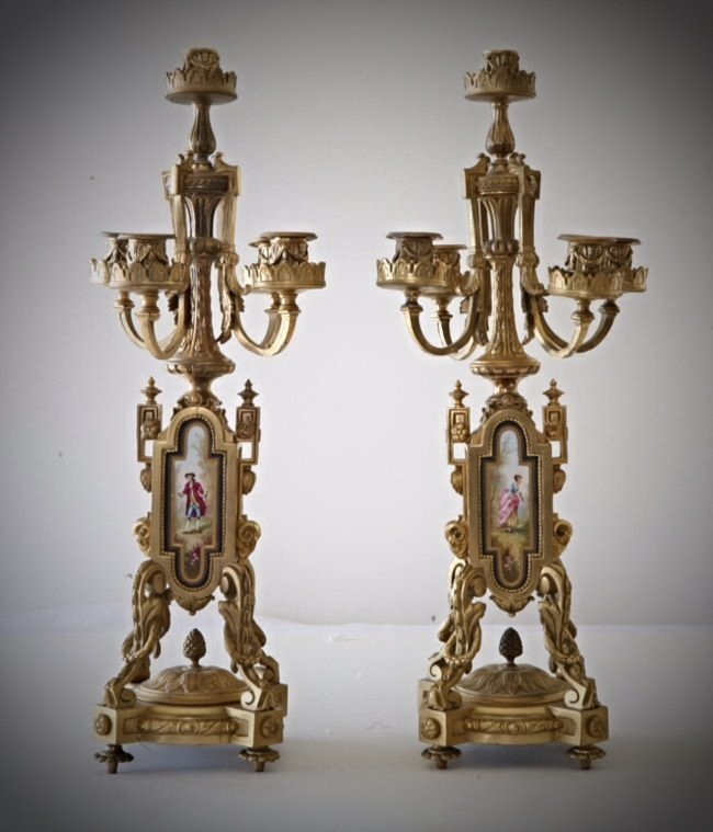 A PAIR OF 19TH CENTURY SEVRES AND ORMOLU CANDLABRA
