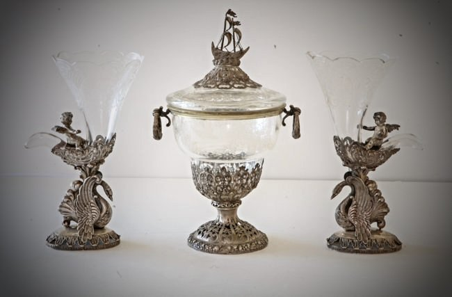 A CONTINENTAL SILVER AND ETCHED GLASS GARNITURE