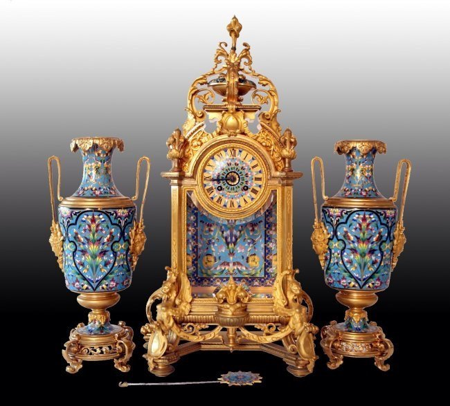 AN IMPOSING ORMOLU AND CHAMPLEVE ENAMEL CLOCK SET