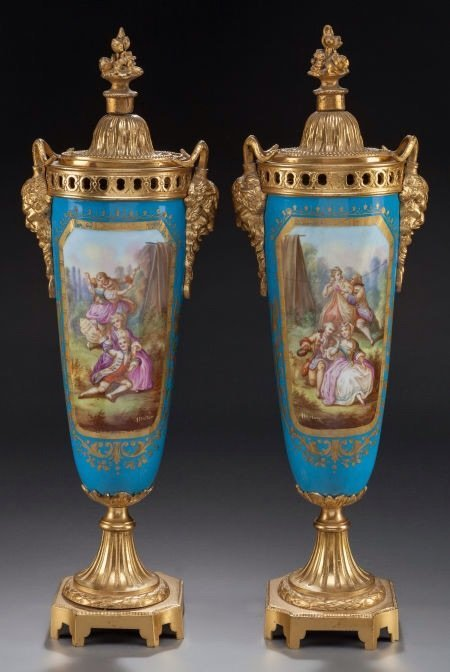 A PAIR OF 19TH CENTURY ORMOLU MOUNTED SEVRES VASES