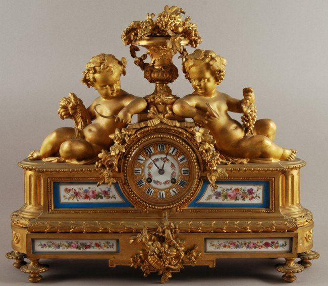 48: French 19C Gilt Bronze Enamel Puttis Sevres Clock