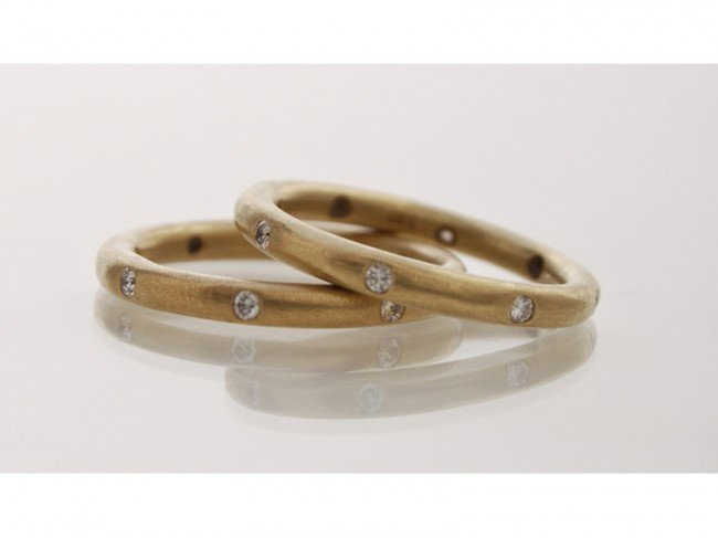 108: Pair of 18K Gold Diamond Eternity Band Rings