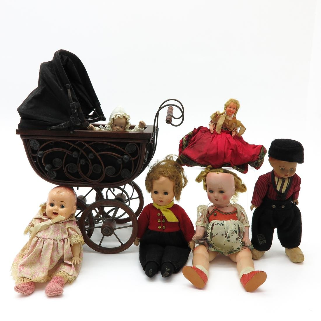 Diverse Lot of Vintage Dolls and Carriage