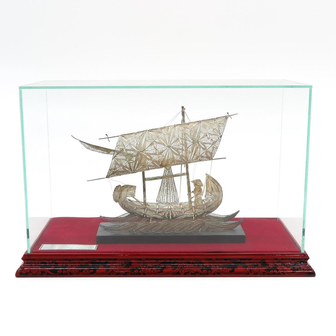 Silver Fishing Boat with Fisherman