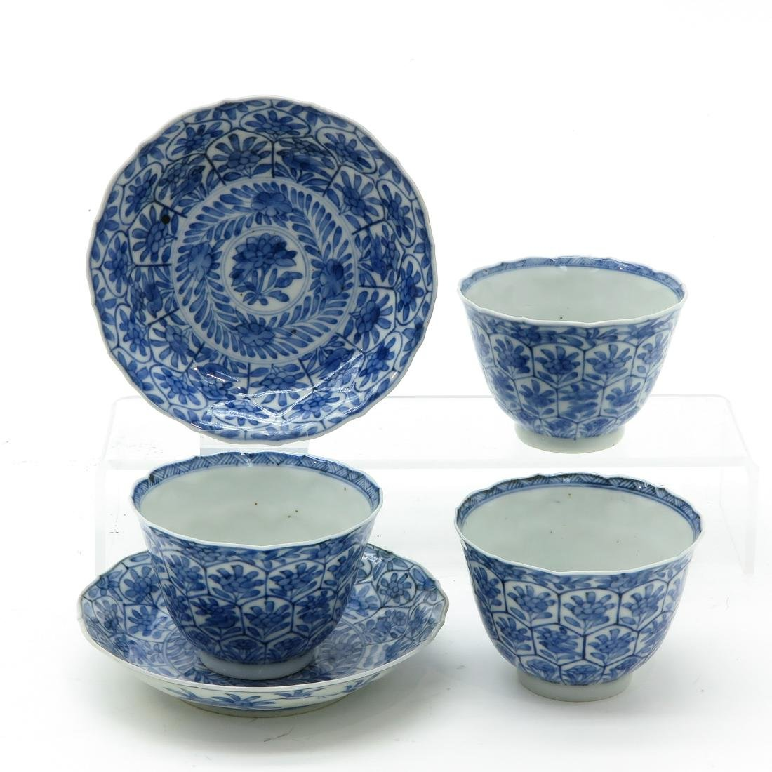 A Lot of Blue and White Cups and Saucers