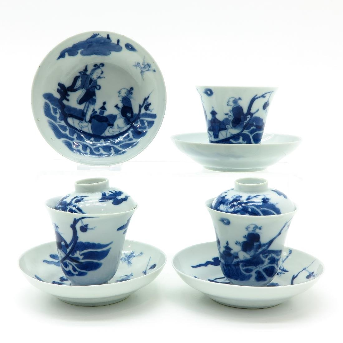 A Lot of Blue and White Covered Cups and Saucers