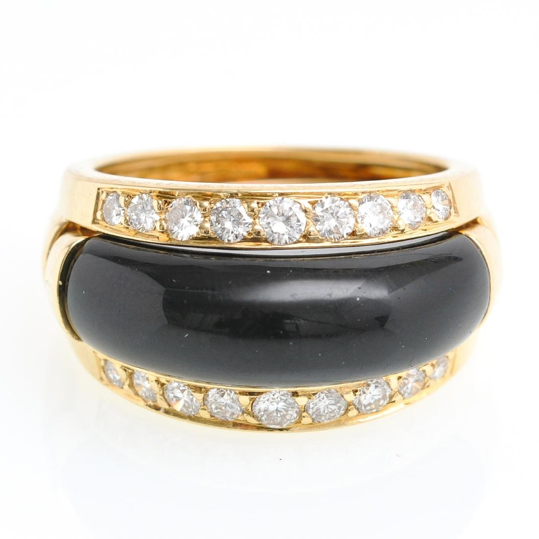 An 18KG Van Cleef & Arpels Onyx and Diamond Band