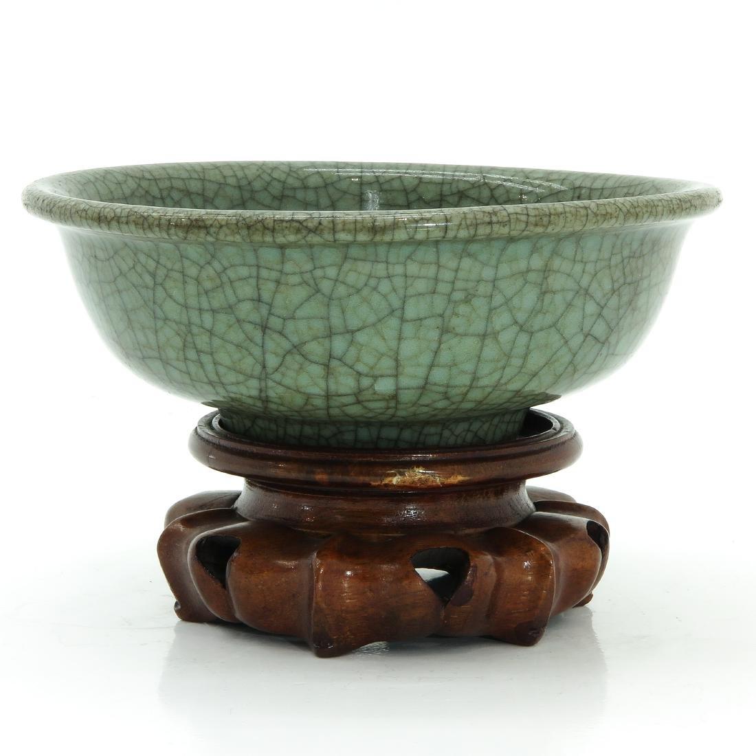 A Celadon Bowl on Carved Wood Base